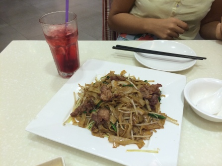 Fried flat noodles with beef and a side drink of some cranberry soda!